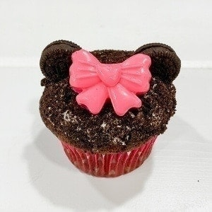 Minnie Mouse cupcake on white background