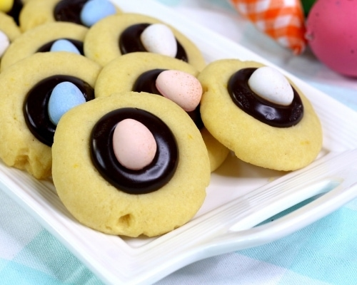 easter thumbprint cookies on white plate